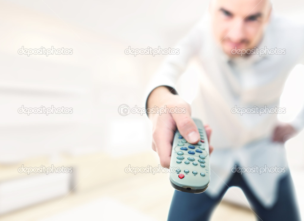 Selective focus image man with remote tv control  Stock Photo #4129614