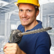 Worker with electric drill - Stock Photo