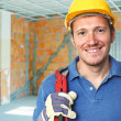 Stock Photo: Smiling manual worker