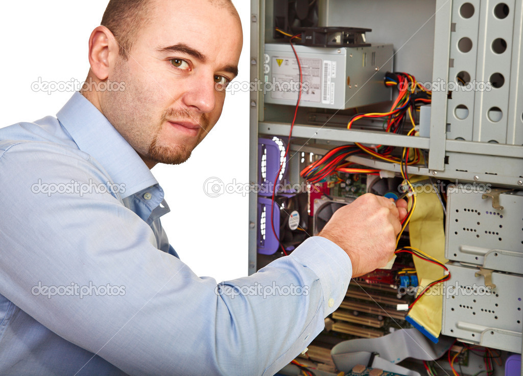Young worker on duty repair pc — Stock Photo #4448477