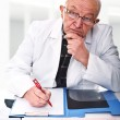 Royalty-Free Stock Photo: Caucasian senior doctor