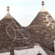 Trulli roof and blue sky - Stock Photo