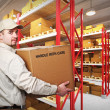Delivery man in warehouse - Stock Photo