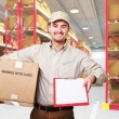 Delivery man in warehouse — Stock Photo #4715745