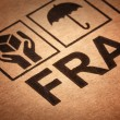 Fine image close up of fragile symbol on cardboard - Stock Photo
