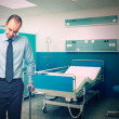 Stock Photo: Mwith crutch in hospital