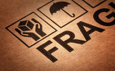 Fine image close up of fragile symbol on cardboard — Stock Photo