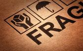 Fine image close up of fragile symbol on cardboard — Stock Photo