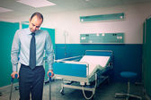 Man with crutch in hospital — Stock Photo