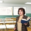 Woman teacher at school — Stockfoto