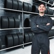 Stock Photo: Mechanic and garage background