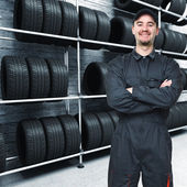 Mechanic and garage background — Stock Photo