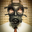 Businessmwith gas mask — Stock Photo #5349850