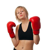 Fit girl in red boxing gloves — Stock Photo