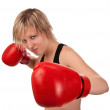 Beautiful fit girl in red boxing gloves — Stock Photo #4638776