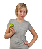 Beautiful young woman holding green apple — Stok fotoğraf