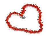 Beads of red coral in the shape of heart — Stock Photo