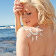 Young woman with sunscreen sun — Stock Photo
