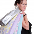 Young woman with shopping bags on white — Stock Photo