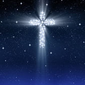 Glowing religious cross in stars — Stock Photo