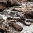 Pure clean water over rocks - 