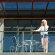 Young woman on balcony — Stockfoto
