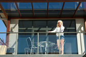 Young woman on balcony — Stock Photo