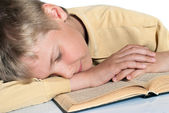 The teenager fell asleep reading a book. Schooling. — Stock Photo
