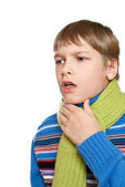 The child has a sore throat. He tied a warm scarf. — Stock Photo