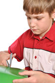 The schoolboy the teenager passes labour training of a cutting — Stock Photo