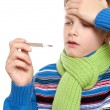 Adolescent temperature. The boy took it for its thermometer. — Stock Photo