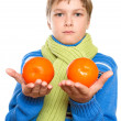 Teen Shows oranges. He tied a warm scarf. — Stock Photo