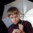 Portrait of a young man. In his hands he held a white umbrella. — Stock Photo
