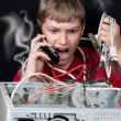 Royalty-Free Stock Photo: Repair your computer. A young man calls to technical support.