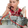 Stock Photo: Repair your computer. A young man calls to technical support.