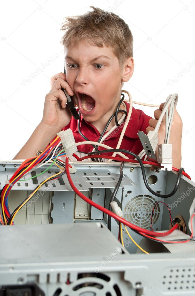 Repair your computer. A young man calls to technical support.  Stock Photo #5213893