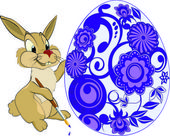 Hare and an Easter egg.Cartoon — Stock Vector