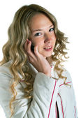 Dívka v bílém plášti s mobilním telefonem — Stock fotografie