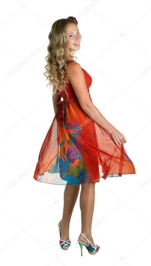 Dancing beauty girl in orange on white background. Isolation  — Stock Photo #3999397