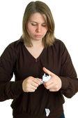 Women breaks off a paper — Stock Photo