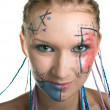 Smiling girl with plaits and geometrical makeup — Stock Photo