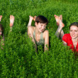 Beautiful girls lay on grass — Stock Photo