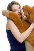 Girl holds the Toy animal — Stock Photo