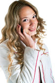 Smiling girl in white jacket with cellular phone — Stock Photo