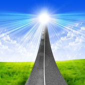 Road stretches into a bright blue sky — Stock Photo