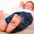 Small faces painted on soles — Stock Photo #5212291