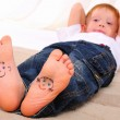 Small faces painted on the soles - Stock Photo