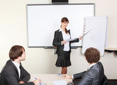 Young business woman making presentation — Stock Photo