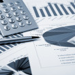 Financial charts and graphs — Stock Photo #5228925