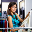 Young womin shop buying clothes — Stock Photo #5228941
